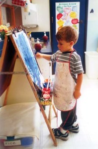 Child Drawing On Canvas