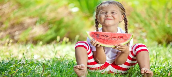 A child eating watermellon