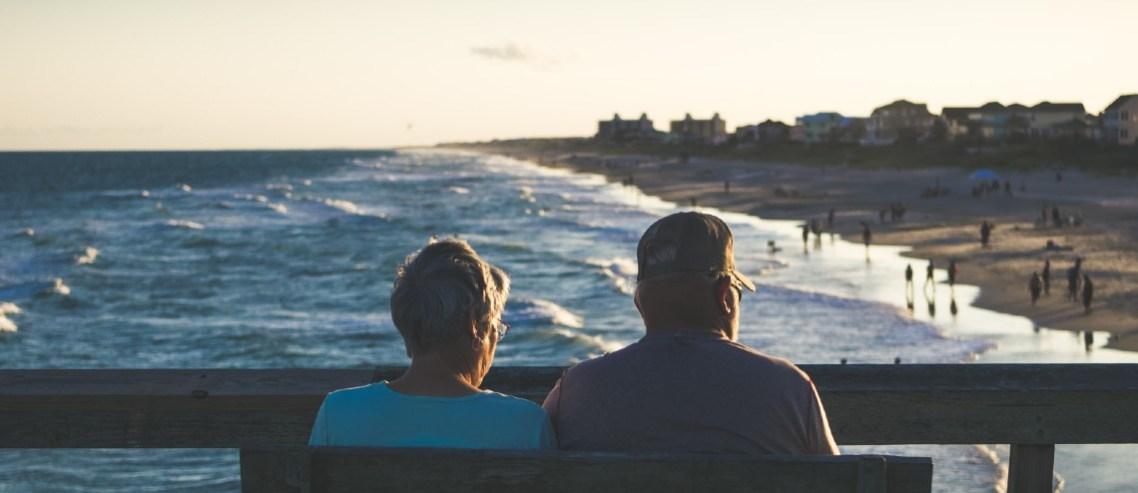 Elderly couple overlooking a beach in front