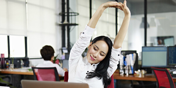 singapore woman embodying a corporate wellness program