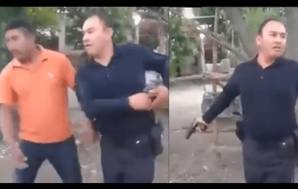 """Sin saber qué hacer, policía dispara su arma para """"disuadir"""" una pelea callejera #VIDEO"""