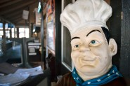 A welcoming chef figure