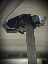 Seatbelt hanging from the ceiling