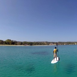 Learning to paddle board Jamacian Style