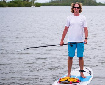 Paddles By The Sea Tshirt on a paddler boarder in Vero Beach