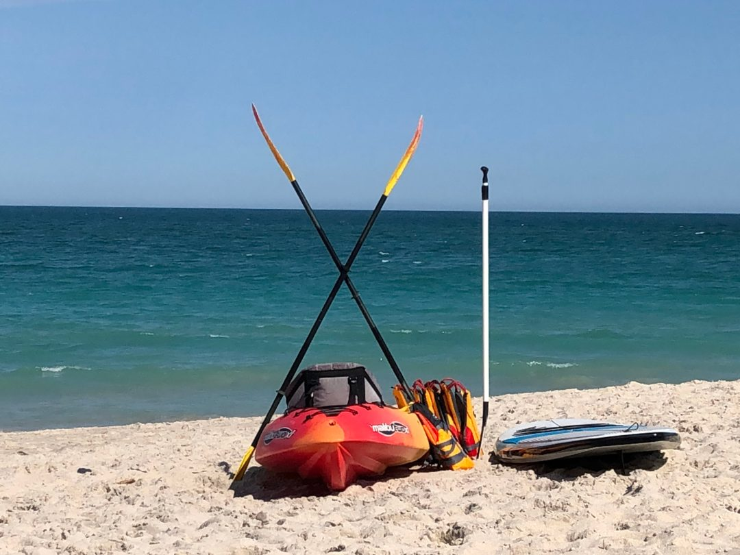 Kayak and paddle board at the beach