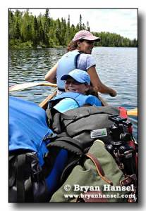 Paige's first canoe trip in the BWCA with a Hobb Creek pack in view.