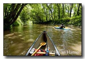 Canoeing down Clear Creek in Iowa.