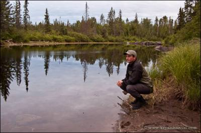 On the side of a river in the Boundary Waters.