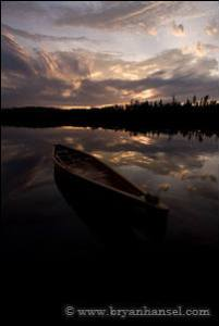The sky looks good, but the canoe is too dark.