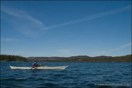 Paddling past the mainland in the Susie Islands.
