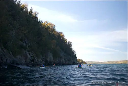 Kayaking past the cliff on Pigeon Point.