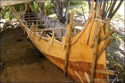 Birchbark canoe on a building bed