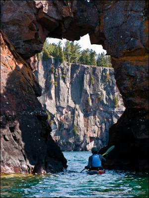 Paddling through the Tettegouche sea arch on the way to Shovel Point.