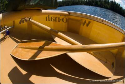 Two Sawyer Paddles crossed in a Wenonah canoe.