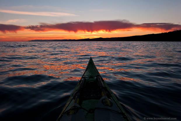A kayak and an expanse of Lake Superior at sunset.