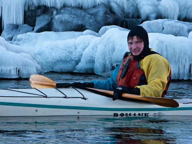 Kayaker paddling on Lake Superior in winter.