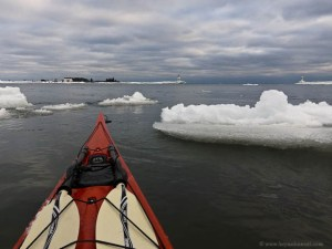 Paddling through anchor ice in the Grand Marais harbor.