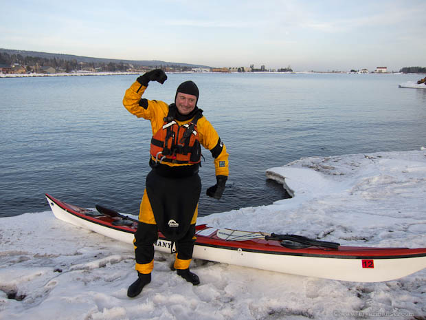A paddler dressed with the right gear for kayaking in winter.