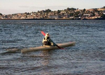 Bill Samson paddling his baidarka.