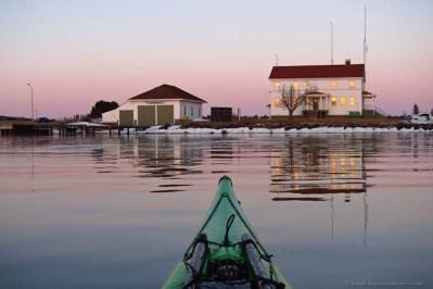 winter kayaking in the Grand Marais harbor