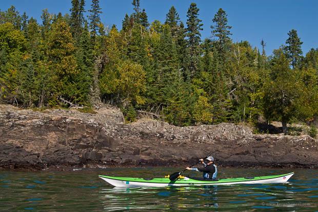 Kayaker paddling without kayak weathercocking on Lake Superior.