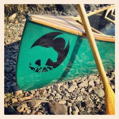 bow of a canoe, paddle, bear