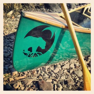 bow of a canoe, paddle, bear