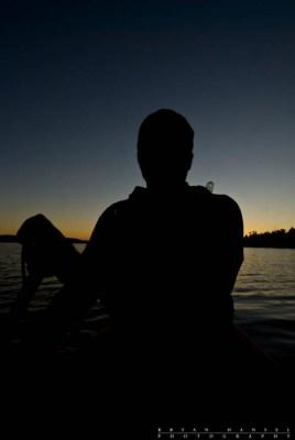 Self-portait silhouette while taking a twilight solo paddle on Ogishkemuncie Lake.