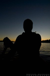 Self-portait silhouette while taking a twilight solo paddle on Ogishkemuncie Lake.