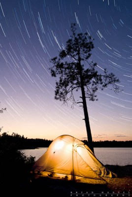 A tent under startrails in the BWCA. Red Rock Bay on Sag.