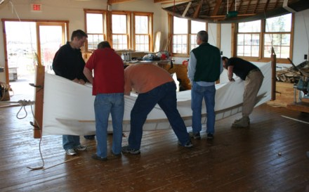 Greenland kayak being skinned.