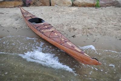 cedar strip kayak on beach