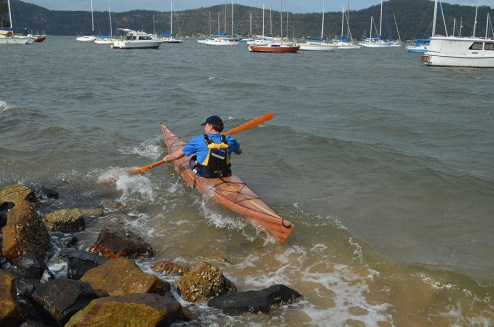 launching a cedar strip kayak