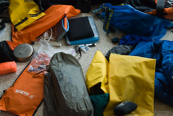 kayaking and camping gear on the floor