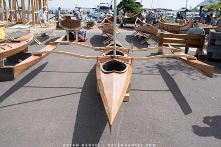 Three-person, sailing canoe