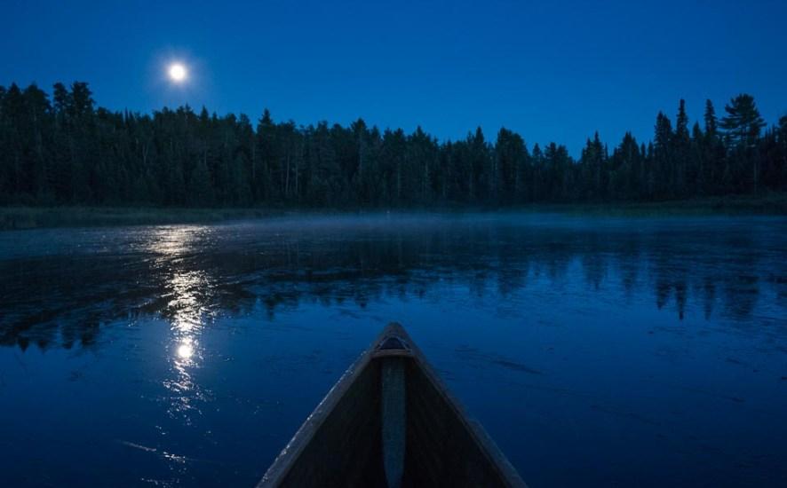 canoe in blue hour under the full moon
