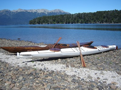 two skin on frame kayaks on beach