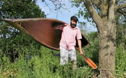 portaging a light wood canoe