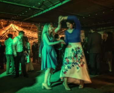 Guests ceilidh dancing at The Barn, South Milton, Devon