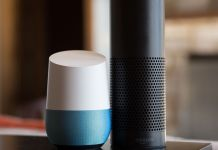 A picture of a Google Home next to an Echo