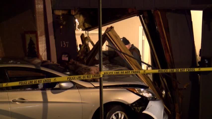 Car slams into Scranton apartment building