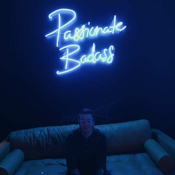 Passionate Badass neon sign - Aaron at SheDoesTheCity 10 year event