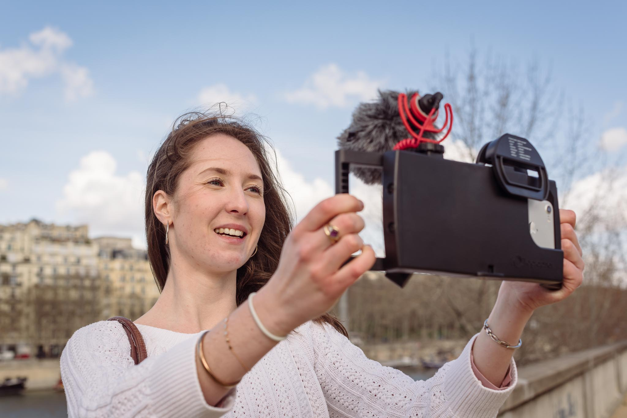 lifestyle photography in Paris of woman vlogging with iPhoneography equipment
