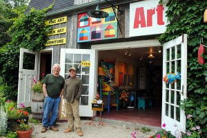 Tom Always & Peter Blais, owners and artists standing in front of the Maritime Painted Saltbox Gallery