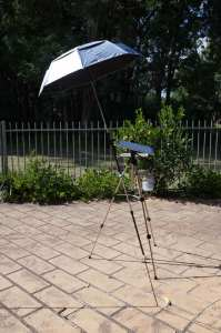 Umbrella and plein air watercolor easel side view
