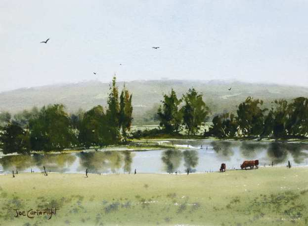 Plein air painting with watercolors of Pond reflections cows hills and trees