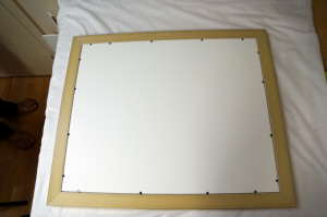 "Acid free mat and backing boards held in place with flexible ""points"""