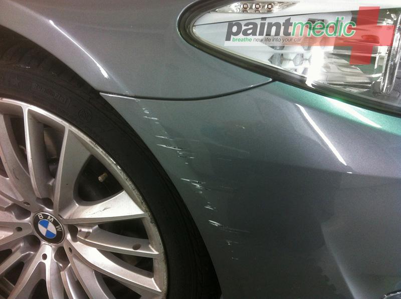BMW bumper scratch before Paintmedic repair