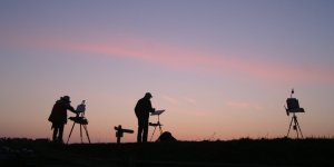 Artists silhouetted at Paint Out Wells 2015 sunrise